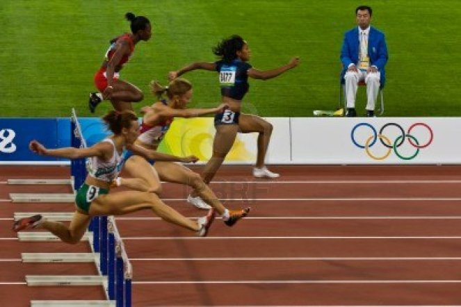 hurdles beijing-china-olympics--aug-18-2008-female-athletes-competing-in-100-meter-sprint-for-women