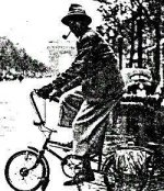 man with pipe on bike