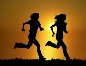 two-women-running-at-sunset-sunrise