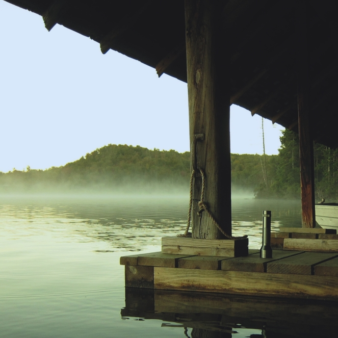 mist, a dock, on a lake