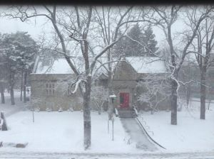 View of the McIntosh Gallery and its inviting red door, from my office window during the late winter snowstorm yesterday.