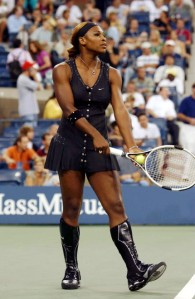Serena Williams in black tennis dress and knee high boots at the US Open in 2004.