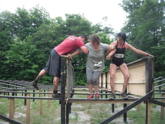 Samantha climbing the balance beam