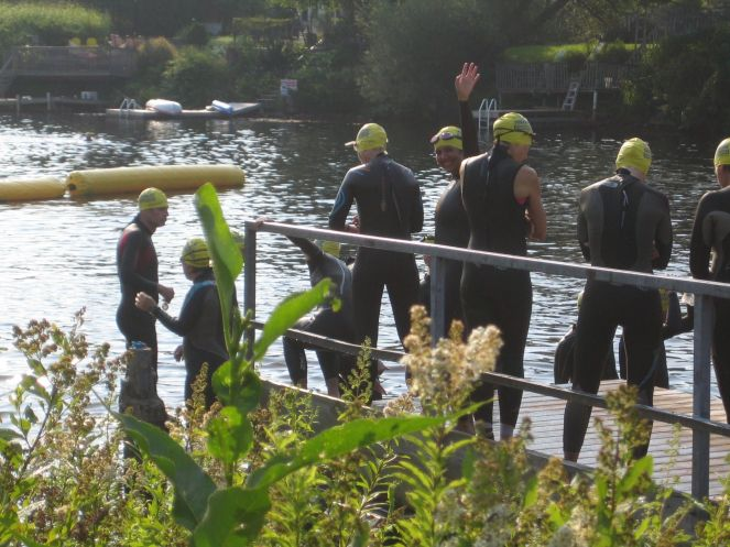 Lining up in the water beside the dock for the swim at Bracebridge. That's me with the yellow cap. :)
