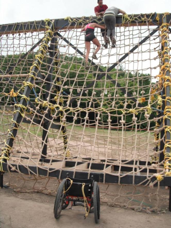 Samantha climbing a cargo net