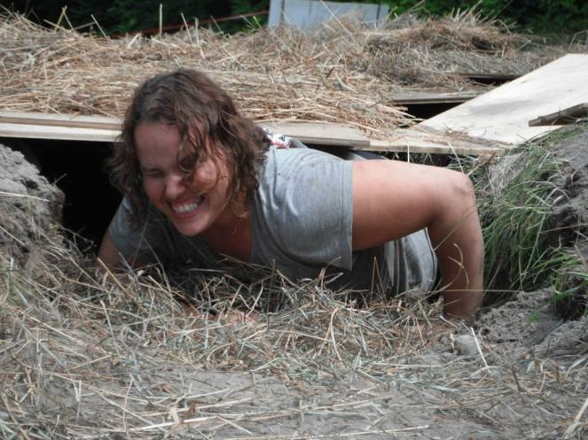 Samantha crawling under an obstacle