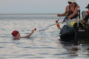 Annaleise Carr takes in some nutrition during her Lake Ontario crossing. Photo credit: Toronto Star. http://www.thestar.com/news/gta/2012/08/26/annaleise_carr_lake_ontario_swimmers_team_key_to_her_successful_crossing.html