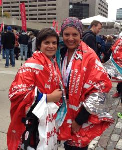 After the race, with foil blankets and food bags.