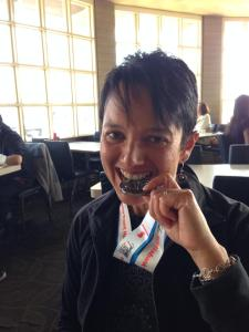 Biting into my medal at lunch after the race.