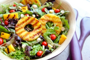 green salad with grilled pineapple and chickpeas.
