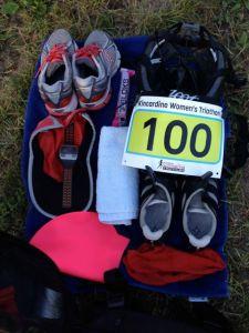 transition set-up, Kincardine Women's Triathlon 2014 -- running shoes, bike shoes, ball cap, bathing cap, socks, gel shots, bike helmet, race bib on belt, small towel, on a half towel beside my bike.