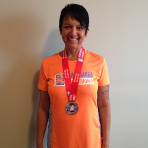 In my orange race t-shirt with my finishers medal.