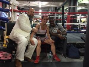 Post fight: Rebecca with her trainer, Delvin, and her partner, Dan. Dan in a white suit, knows how to dress for a boxing match.