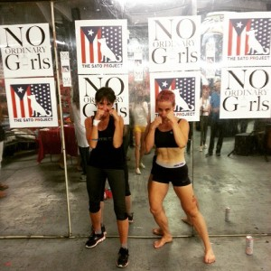 two muscular women posing in fighting stances