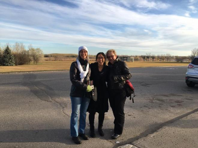 Kate, Audrey, and Sam with the big Saskatchewan sky behind them. Photo credit: Tracy I