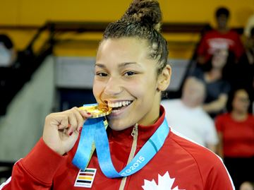 MISSISSAUGA -- Braxton Stone Papadopoulos from Team Canada won the Pan Am wrestling gold in the 63 kg division. Stone Papadopoulos who is from Pickering defeated Katerina Vidiaux from Cuba. July 17, 2015.