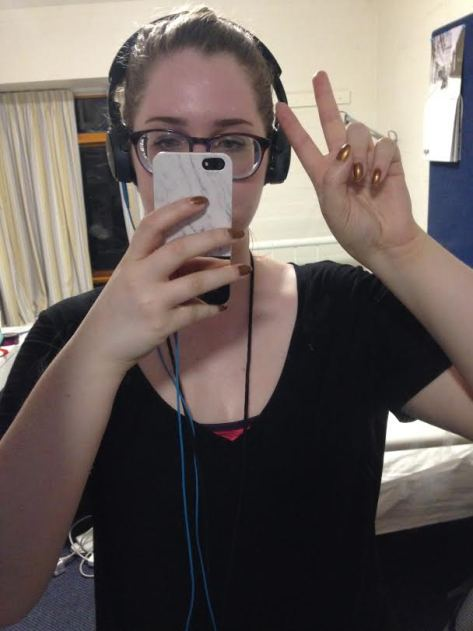 A photo update on my progress - it looks like I was making a peace sign, but I was actually trying to indicate that I had finished my second run of that week.