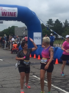 Anita and Tracy high-fiving after crossing the finish line ahead of the 2:30 pace bunny!