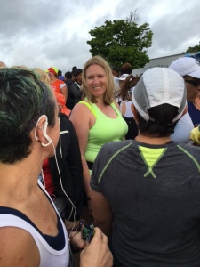 Julie at the starting line. That's Rebecca with the ear buds, Anita with the grey shirt and white cap.