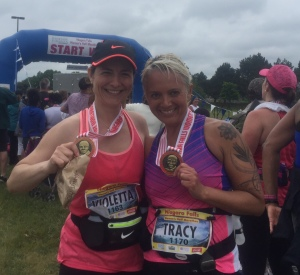 Violetta and Tracy showing off our Harriet Tubman Medals at the finish line.