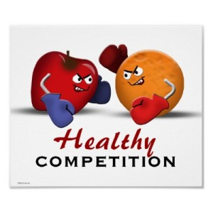 cartoon of an apple and an orange, with eyes and wearing boxing gloves, looking like they'e in a fight, caption: healthy competition.