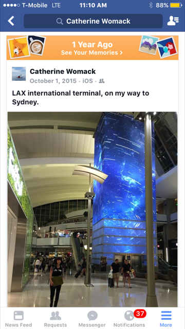 Facebook post featuring a picture of LAX terminal atrium, a person walking in foreground.