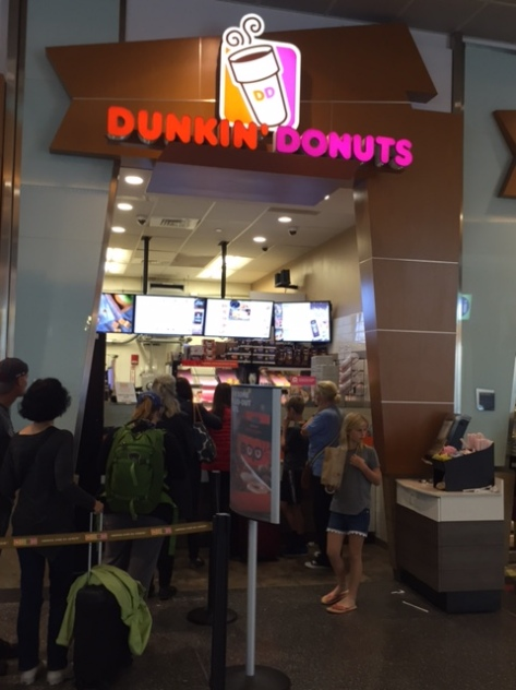 People waiting in line at a Dunkin Donuts in Logan aiport in Boston.
