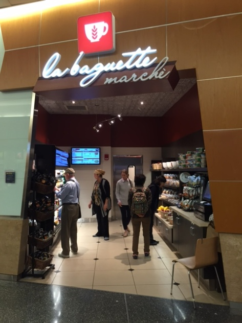 People shopping in an airport food store called La baguette marche, in Logan airport in Boston.