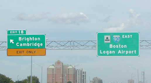 Road signs for Boston Logan airport and Brighton/Cambridge on Interstate 90 in Boston.