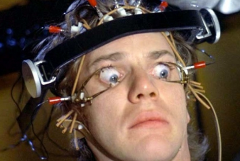 "Alex from the movie ""A Clockwork Orange"", hooked up to electrodes, with his eyes forced open for viewing."