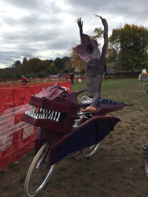 dragon bike with papier-mache ghoul on back, rider absent.