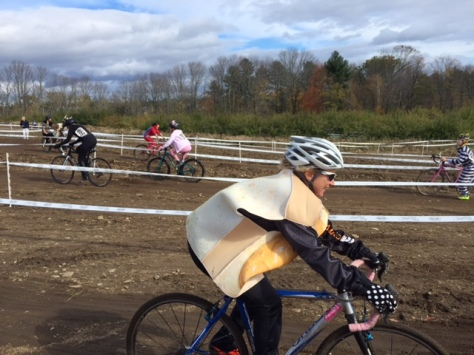 rider in peanut-butter poncho on cross course