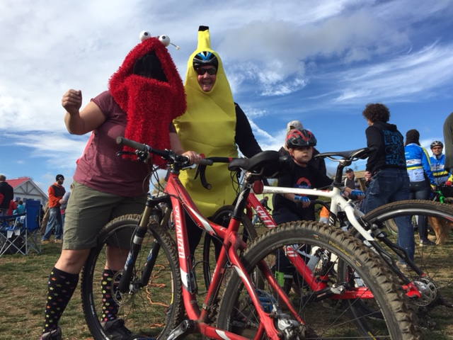 Elmo masked and banana-costumed cross racers