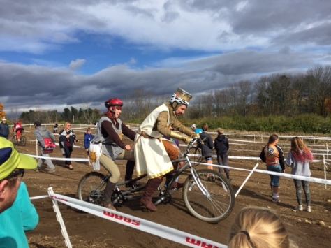 Medieval costumed riders on a tandem bike