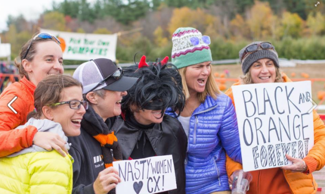 A group of fans at the cross race, with signs