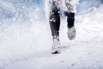 athlete-woman-is-running-during-winter-training-outside-in-cold-snow-weather-stock-photo