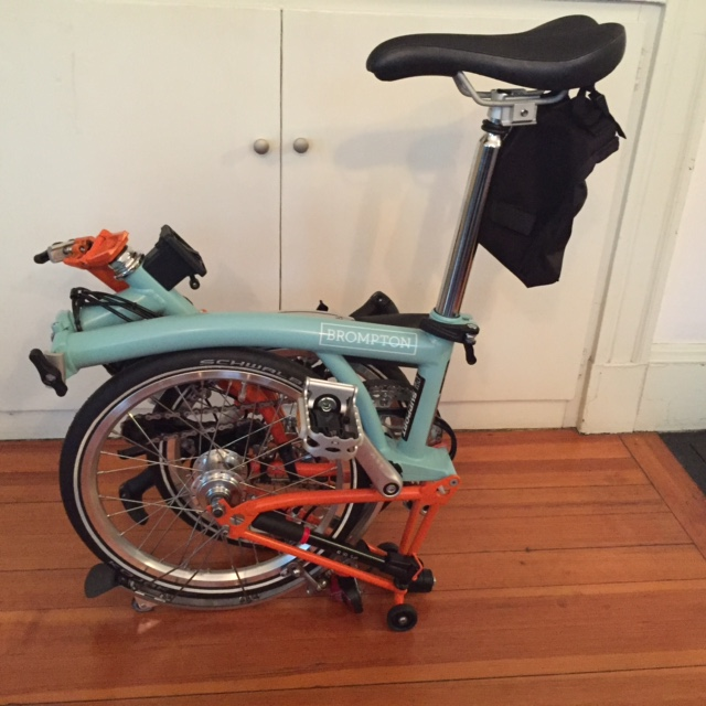 The Brompton with seat post pulled up