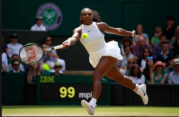 Serena Williams running for a shot on the tennis court, earing a white top and skirt