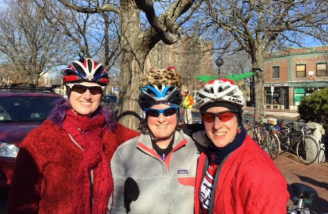 Me plus two friends in cycling clothes and Christmas hats, getting ready to do the Jingle Ride