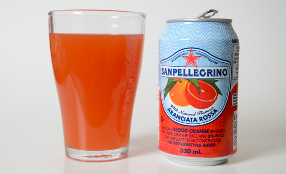 Image description: On the left, a glass of blood orange San Pelingrino. On the right, the can from which it came.
