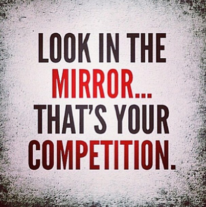 "This color photo depicts a saying in block letters in black and red on a white background with faded grainy corners: ""Look in the mirror...that's your competition."""