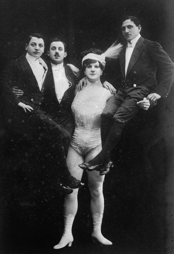katie sandwina holding 3 dudes