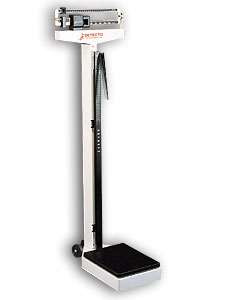 Picture of a white upright white gym scale with a black platform to stand on and slider weights on the top part to move across to determine weight.