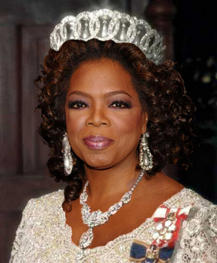 Oprah in a tiara, jewels, and a white beaded gown
