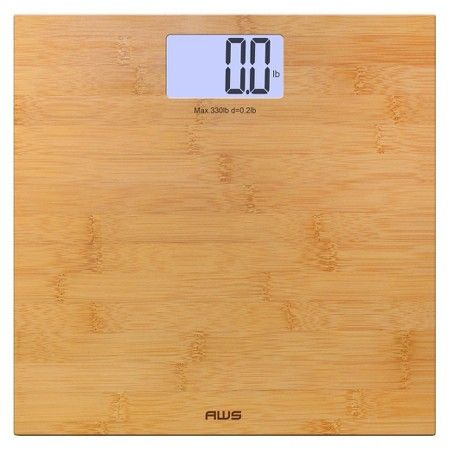 Image description: A digital scale with a wooden surface which reads 0.0.