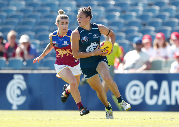 Image of women playing football from the AFL site, http://www.afl.com.au/