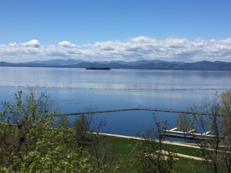 view of Lake Champlain in Burlington VT on a sunny day with blue skies and a few clouds