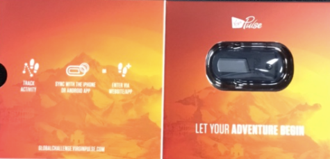 "Virgin Pulse tracker still in its orange package. Underneath the oval shaped grey tracker gadget it says, in white block letters, ""LET YOUR ADVENTURE BEGIN."""