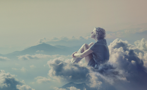 a girl in tones of blue and silver, sitting on a cloud, gazing at a blue-gray hazy mountain top and sky.