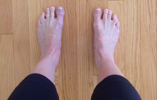 One version of foot position in mountain pose-- feet on the floor hips' width apart.